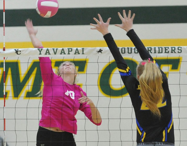 Yavapai's Bailey Anderson (10) goes for a kill against ERAU's Lyndsey Weiler (22) on Wednesday, Oct. 4, 2017, in Prescott. (Les Stukenberg/Courier)