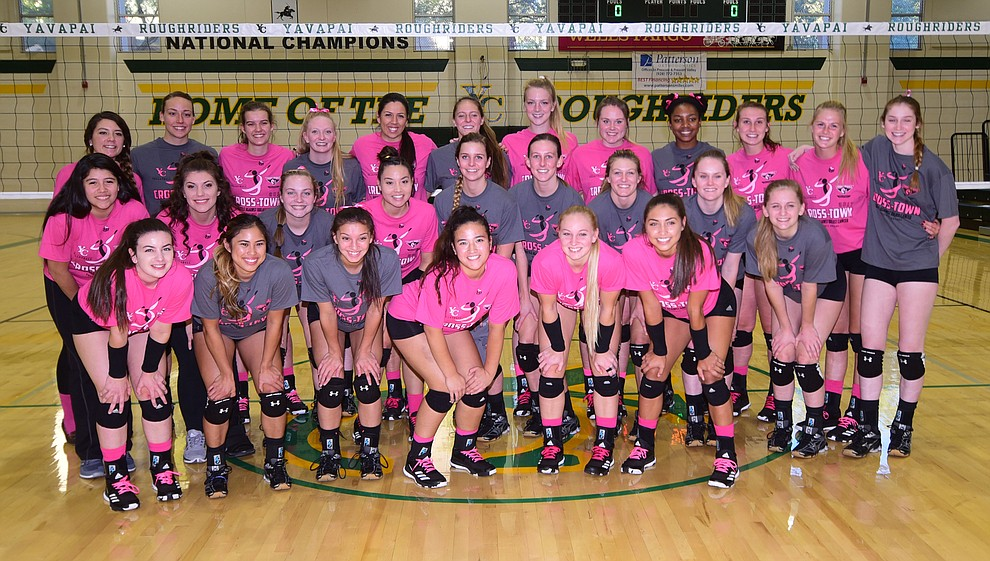 Yavapai and ERAU players gather for a group photo before the Battle Against Breast Cancer volleyball game Wednesday night at Yavapai College in Prescott. (Les Stukenberg/Courier)