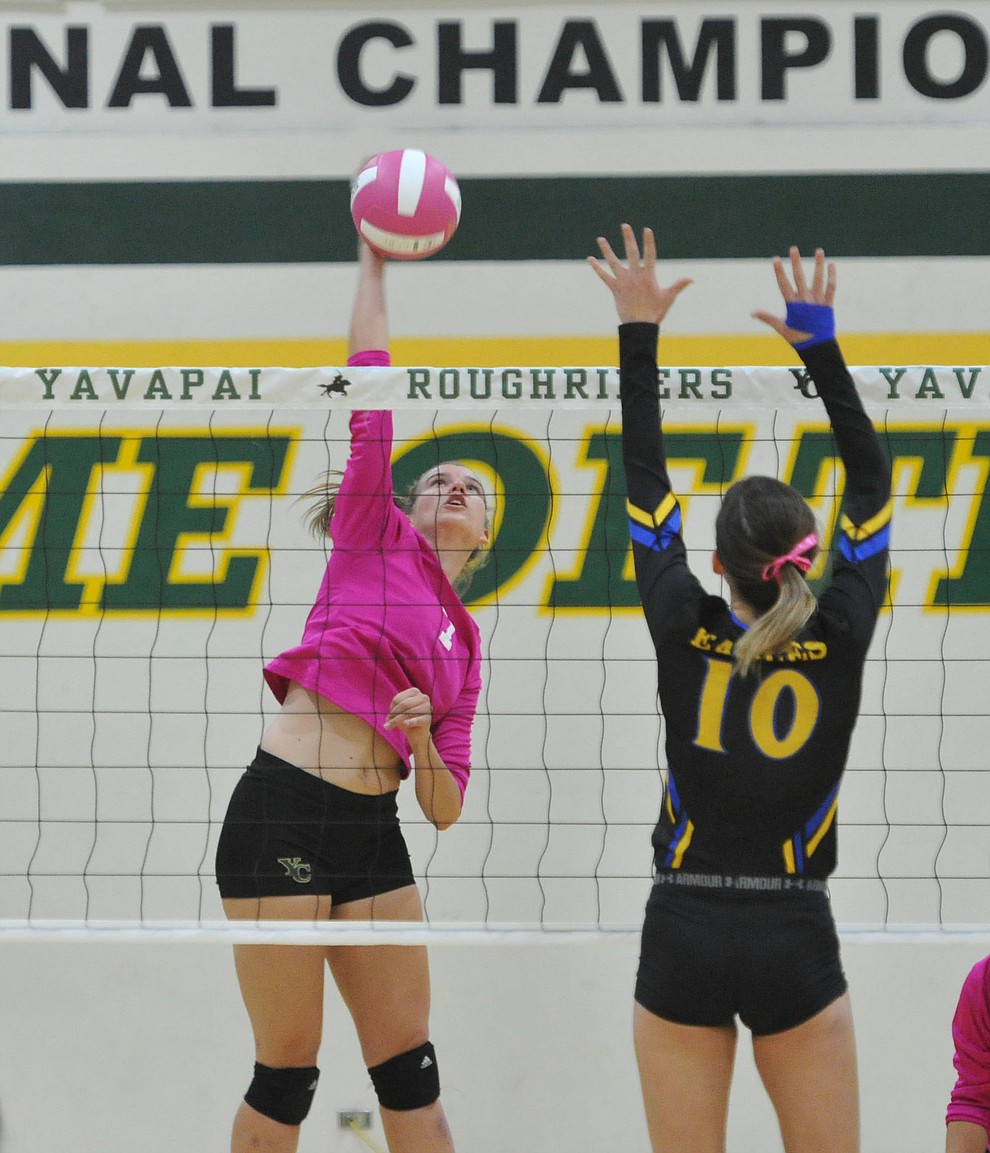 Yavapai's Nynke de Vries (7) hits a kill against ERAU's Jalin Yoder (10) in the Battle Against Breast Cancer volleyball game Wednesday night at Yavapai College in Prescott. (Les Stukenberg/Courier)