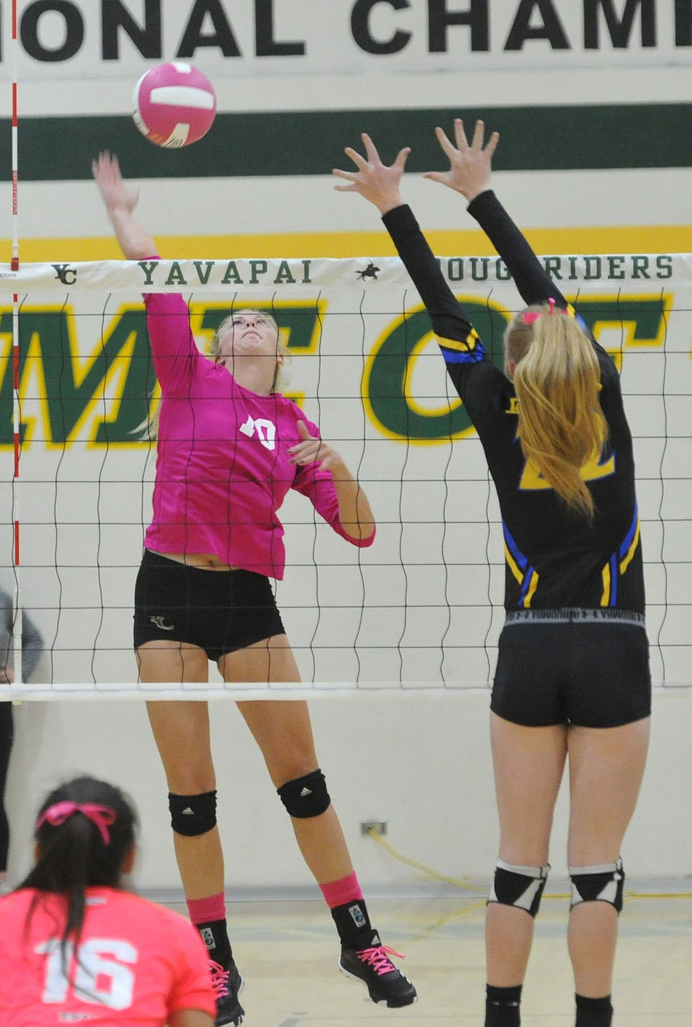 Yavapai's Bailey Anderson (10) goes for a kill against ERAU's Lyndsey Weiler (22) in the Battle Against Breast Cancer volleyball game Wednesday night at Yavapai College in Prescott. (Les Stukenberg/Courier)