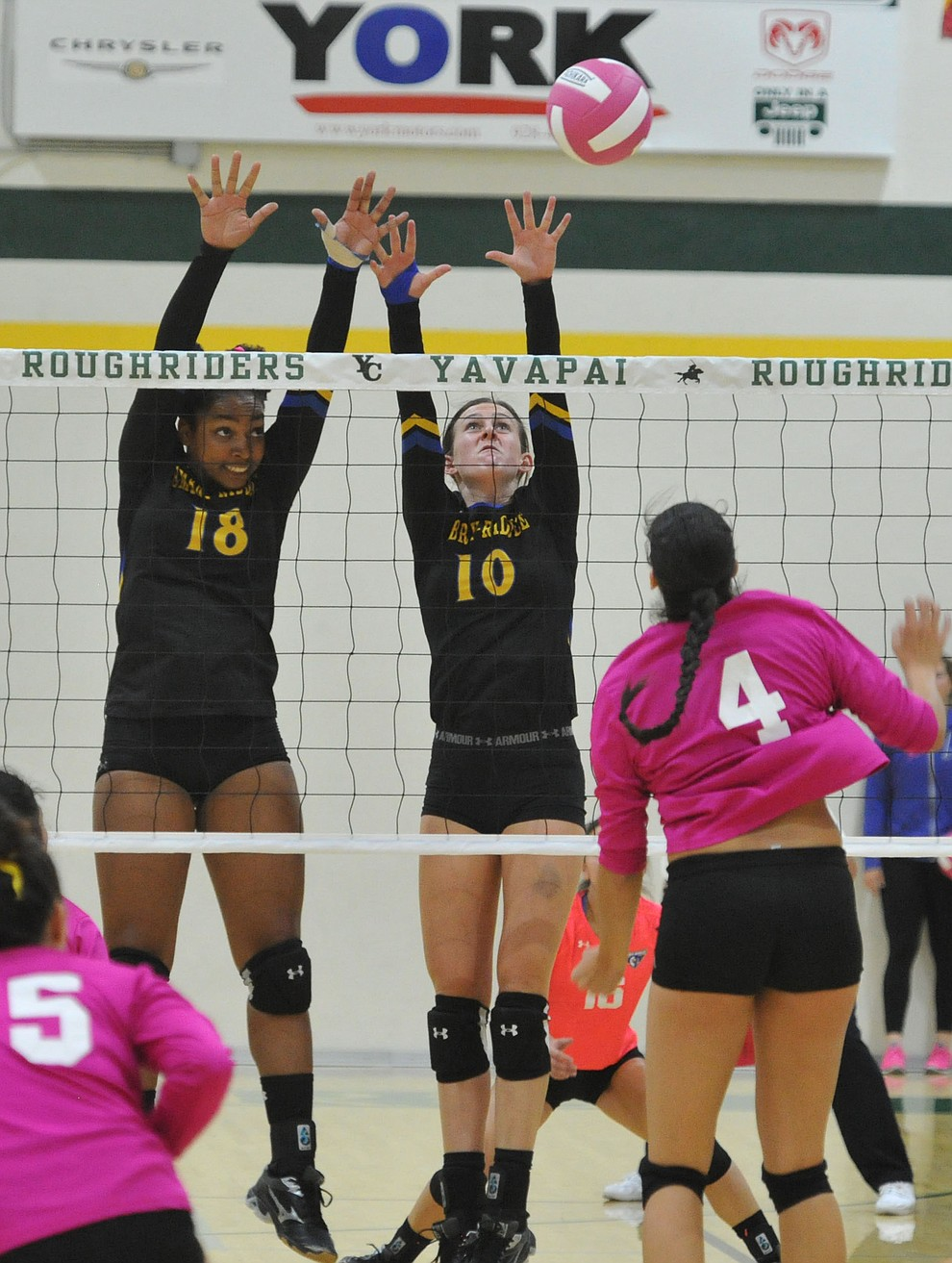 ERAU's Sharik Joseph (18) and Jalin Yoder (10) go for a block on Yavapai's Kaytlin Yost (4) in the Battle Against Breast Cancer volleyball game Wednesday night at Yavapai College in Prescott. (Les Stukenberg/Courier)