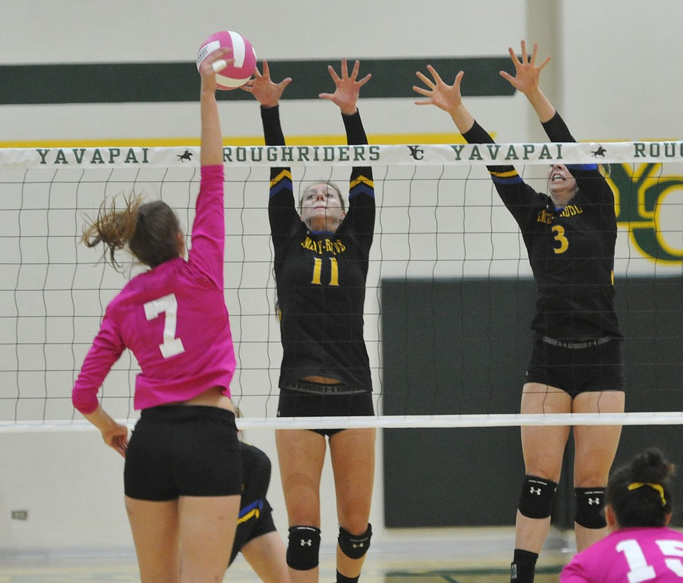 Yavapai's Nynke de Vries (7) gets a kill on ERAU's Audrey Baldwin (11) and Leah DeLaurell (3) in the Battle Against Breast Cancer volleyball game Wednesday night at Yavapai College in Prescott. (Les Stukenberg/Courier)