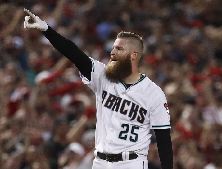 Arizona Diamondbacks' Archie Bradley celebrates his two-run triple against the Colorado Rockies during the seventh inning Wednesday, Oct. 4, 2017, in Phoenix. (Matt York/AP)