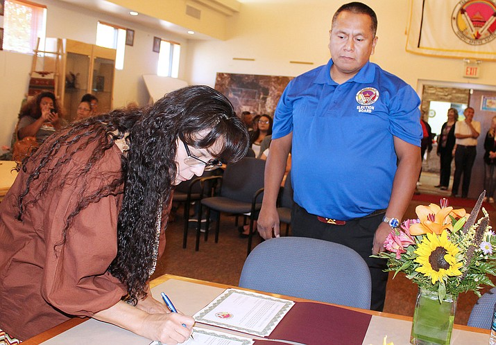 Darlene Rubio signs Oath of Office as Brian Marquez, Chief of Election Office witnesses the signing. Rubio is one of three new members to the Yavapai-Apache Nation's Tribal Council. (Photo by Don Decker/YAN News)