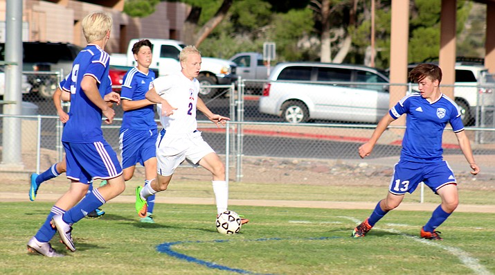 Camp Verde junior Joseph Jones dribbles through the Northland Prep defense on Sept. 26. Jones is a captain for the Cowboys and plays every outfield position for Camp Verde. (VVN/James Kelley)