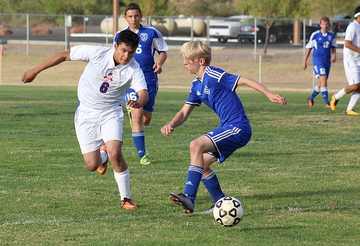 Camp Verde senior Alex Ortiz dribbles past a Northland Prep defender on Sept. 26. Last week at the Old Pueblo Classic, the Cowboys earned draws against No. 2 Blue Ridge and No. 4 Snowflake. (VVN/James Kelley)