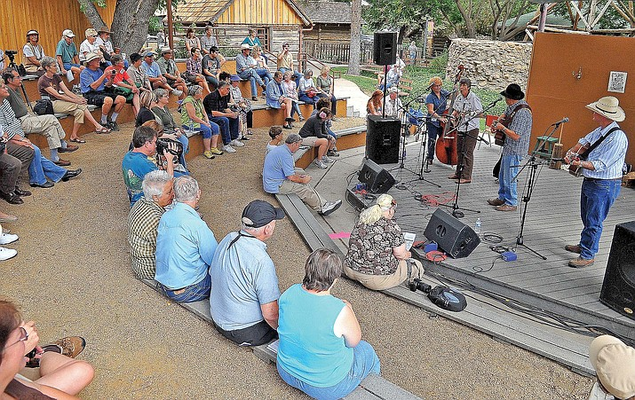 Max and Jenine Bacon and Les and Judy Taylor perform for the crowd at the Amphitheater during the Folk Music Festival at Sharlot Hall in Prescott. (Courier file photo)