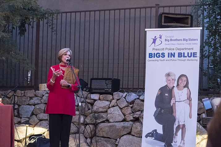 Billie Orr, Prescott councilwoman and honorary chairwoman of the YBBBS Women of Influence, speaks at the WI event held recently at the home of Karen Morse. (YBBBS/Courtesy)