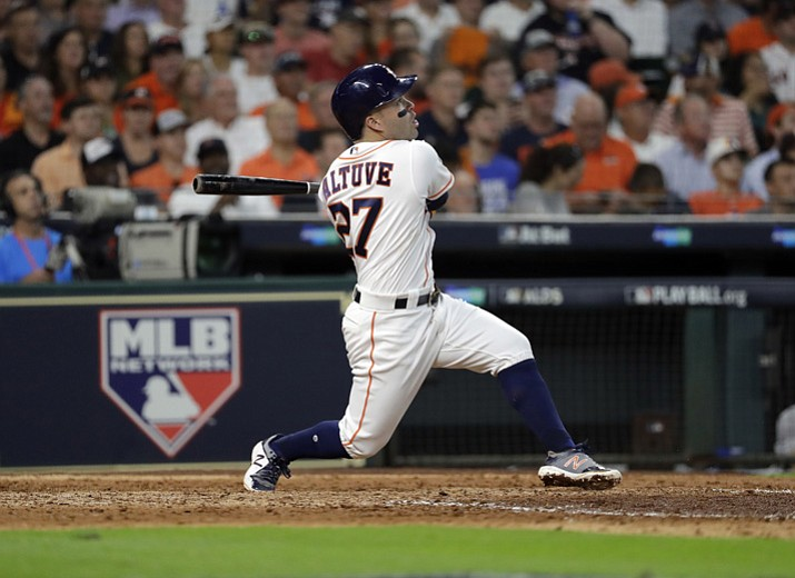 Houston Astros' Jose Altuve watches his a solo home run, his third of the game, against the Boston Red Sox in the seventh inning in Game 1 of the American League Division Series on Thursday, Oct. 5, 2017, in Houston. (David J. Phillip/AP)