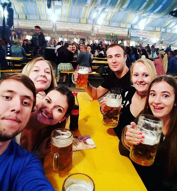 A group of travellers pose for a selfie while at a volksfest in Nuremberg, Germany in September. Kingman Oktoberfest begins at 3 p.m. today at Metcalfe Park.