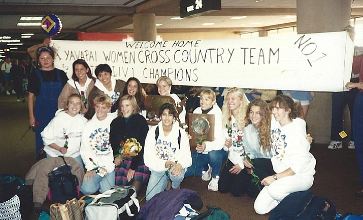 The 1994 Yavapai College cross-country team poses for a photo in the airport upon their return to Arizona after winning the national championship. (Yavapai College/Courtesy)