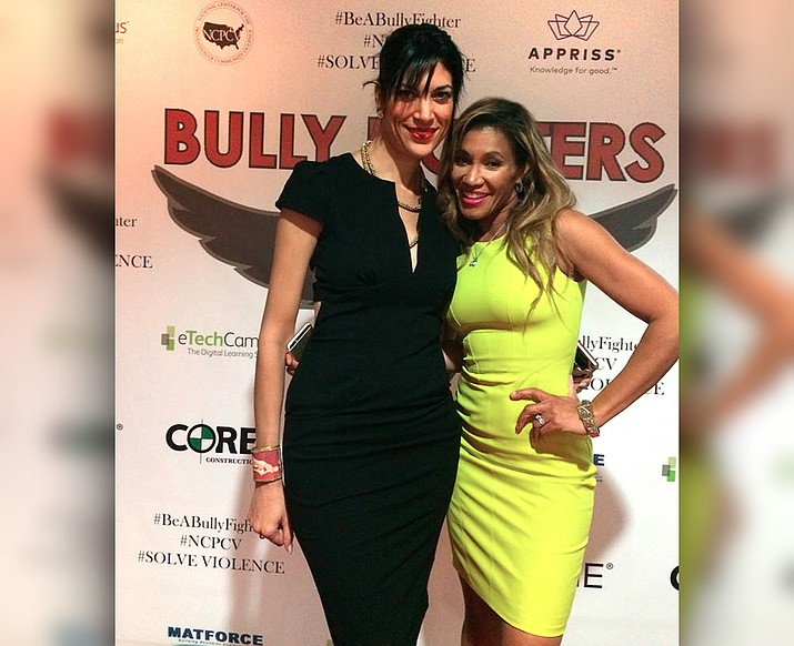 "On the red carpet, writer/director/producer Jupiter Makins, left, and Patricia McKenzie, actress/producer of the film, ""Bully Fighters."""