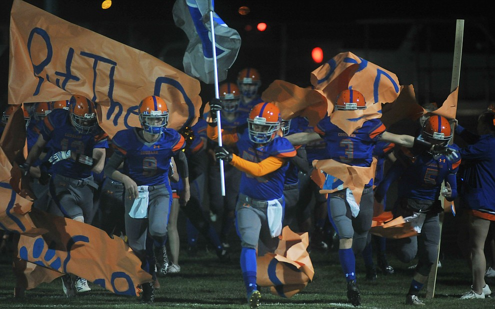 Chino Valley's football players take the field as the Cougars take on the Kingman Bulldogs Friday, October 6. (Les Stukenberg/Courier)