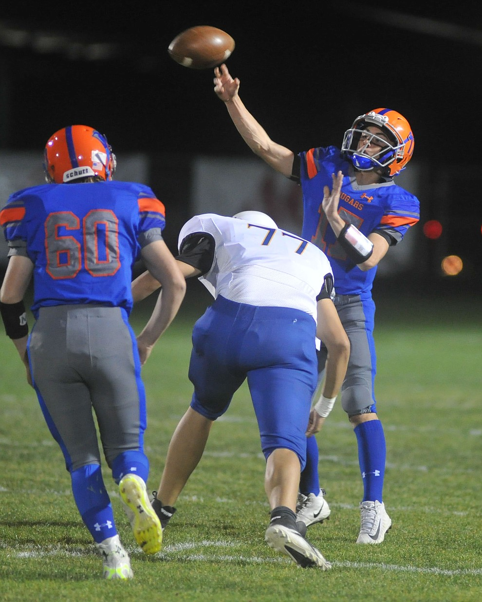 Chino Valley's Seth Jelovic gets pressured by Dimitri Trebiani as the Cougars take on the Kingman Bulldogs Friday, October 6. (Les Stukenberg/Courier)