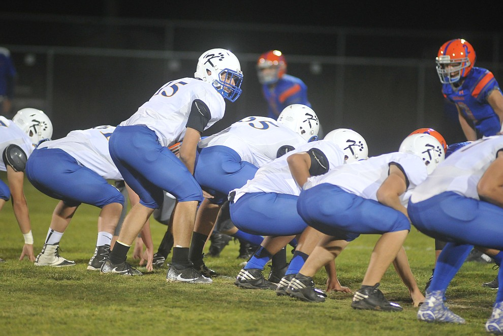 Kingman's quarterback Darrell Mitchell looks over the defense as the Bulldogs traveled to Chino Valley to take on the Cougars Friday, October 6. (Les Stukenberg/Courier)