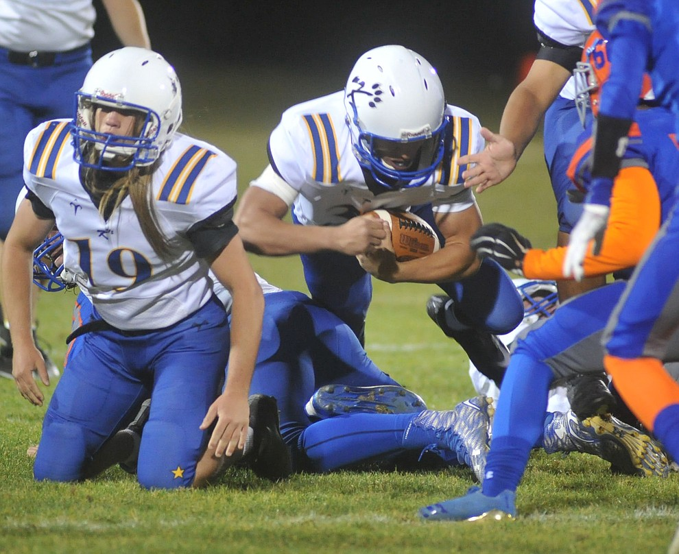 Kingman's Nate Lawson dives for yards as the Bulldogs traveled to Chino Valley to take on the Cougars Friday, October 6. (Les Stukenberg/Courier)