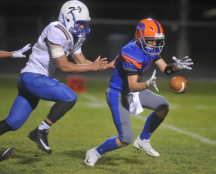 Chino Valley's Seth Jelovic fields a punt as the Cougars take on the Kingman Bulldogs Friday, October 6. (Les Stukenberg/Courier)