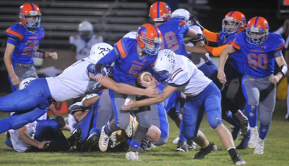Chino Valley's Michael Paulus runs for a first down as the Cougars take on the Kingman Bulldogs Friday, October 6. (Les Stukenberg/Courier)