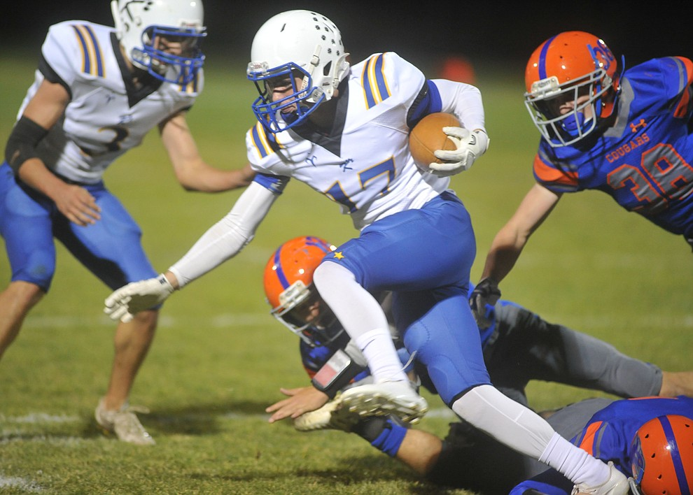 Kingman's James Carter breaks a tackle as the Bulldogs traveled to Chino Valley to take on the Cougars Friday, October 6. (Les Stukenberg/Courier)