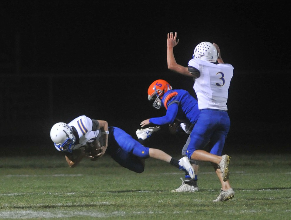 Kingman's Josh Proffit intercepts a pass for a touchdown as the Bulldogs traveled to Chino Valley to take on the Cougars Friday, October 6. (Les Stukenberg/Courier)