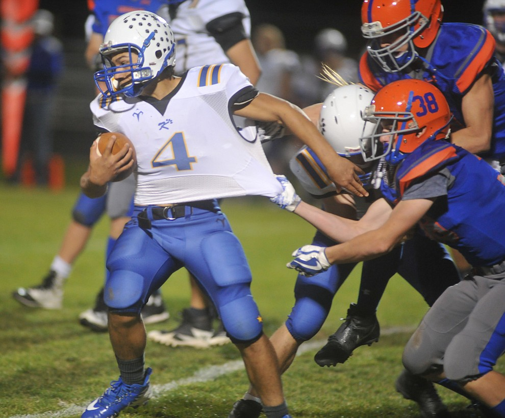 Kingman's Austin Dias tries to break a tackle as the Bulldogs traveled to Chino Valley to take on the Cougars Friday, October 6. (Les Stukenberg/Courier)