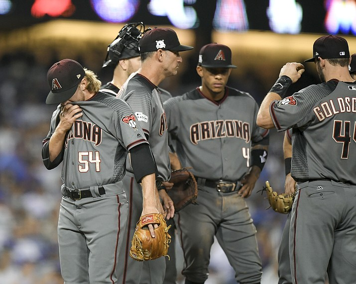 Diamondbacks relief pitcher Jimmie Sherfy is taken out of the game against the Dodgers during the fifth inning of Game 2 of baseball's National League Division Series, Saturday, Oct. 7. (Mark J. Terrill/AP)