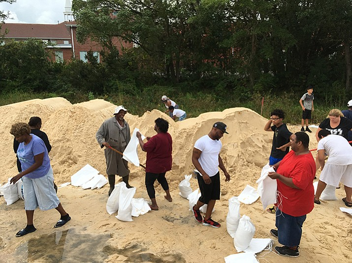People fill sandbags to prepare for Hurricane Nate in Moss Point, Miss., on Saturday, Oct. 7. Storm surge threatens many low-lying neighborhoods in city, which was heavily flooded during 2005's Hurricane Katrina.