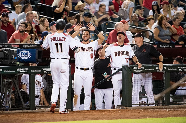 A.J. Pollock is greeted after hitting a home run against the Braves earlier this season. Pollock hit another one in Friday's NLDS 9-5 loss to the Dodgers.