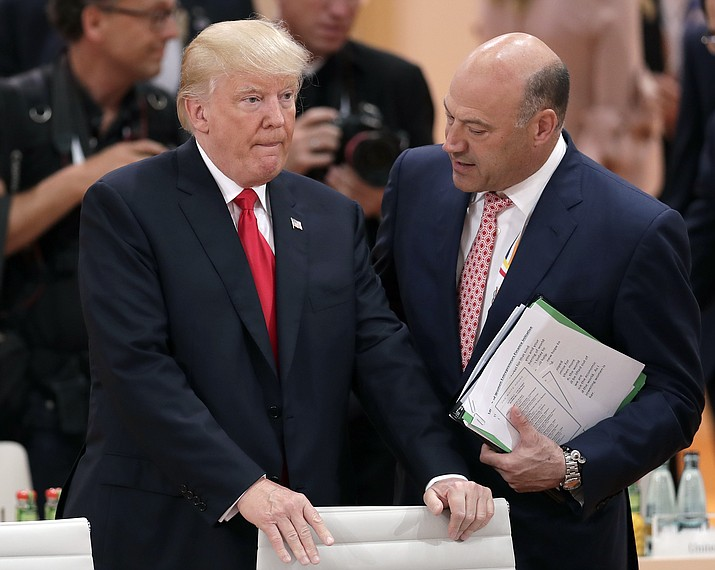 White House chief economic adviser Gary Cohn, right, talks to President Donald Trump prior to a working session at the G-20 summit in Hamburg, Germany. Trump and his Republican partners in a nearly $6 trillion tax-cutting plan insist it would benefit middle-class Americans and not the wealthy. (Michael Sohn/AP, File)