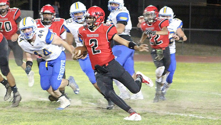 Lee Williams quarterback AJ Herrera passed and rushed for a touchdown in a 23-15 loss Friday at Flagstaff.