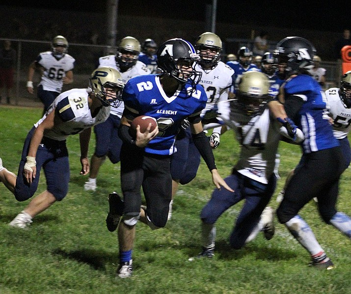 Kingman Academy's Stevie Wusstig rushed for 194 yards and two touchdowns in a 44-14 win at Chandler Prep.