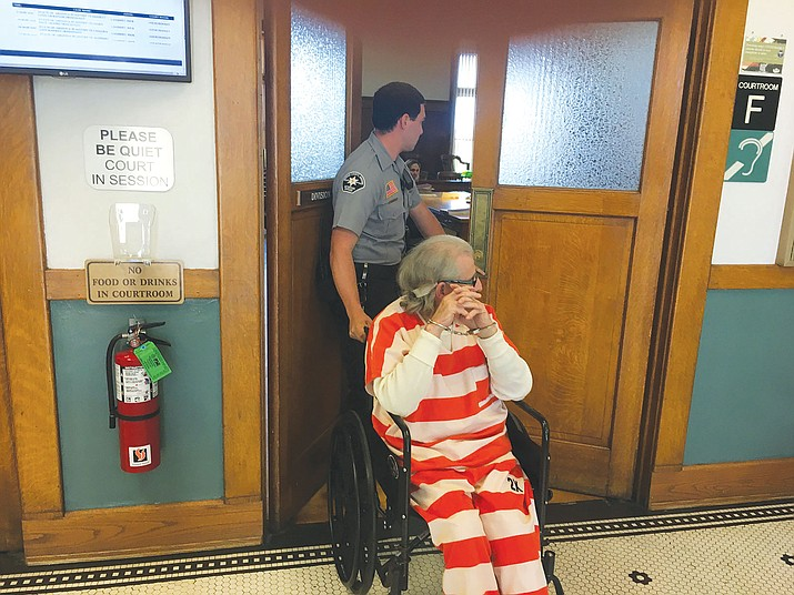 Al Blanco, accused of murdering real estate agent Sidney Cranston, Jr., is wheeled into Judge Rick Lambert's courtroom Friday.