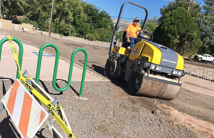 Town of Camp Verde workers resurface the land to the south of the Camp Verde Community Library, as they create 30 additional spaces for patrons. (Photo by Bill Helm)