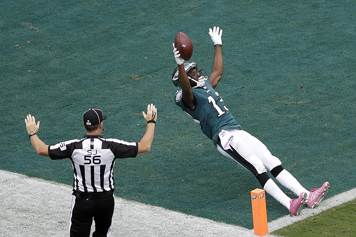 Philadelphia's Nelson Agholor celebrates as he crosses the goal line to score a touchdown during the second half of an NFL game against the Cardinals, Sunday, Oct. 8, in Philadelphia. (Michael Perez/AP)