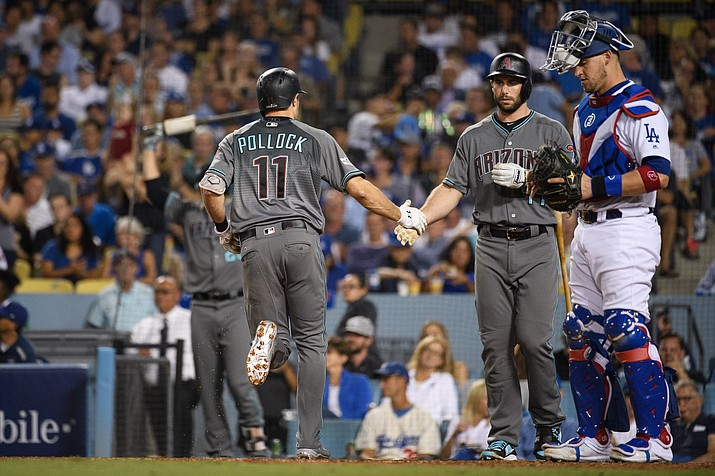Paul Goldschmidt greets A.J. Pollock at home during the Game 1 loss Friday. Goldschmidt homered in Game 2, but it wasn't enough as the D-backs are now down 2-0 in the best of five series.