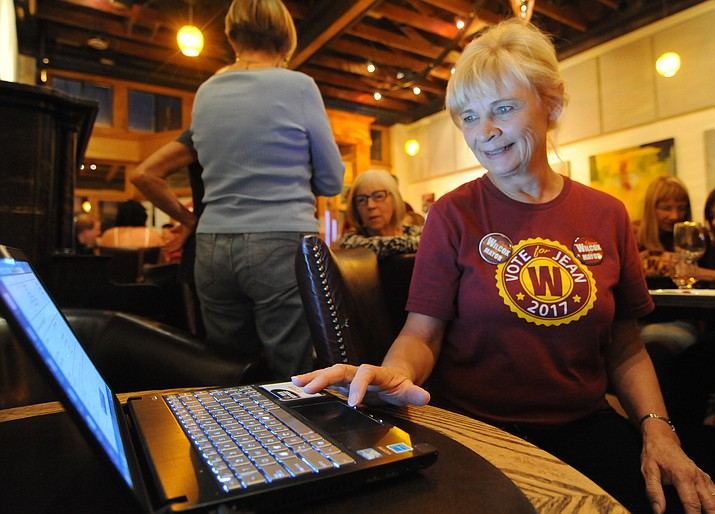 Mayoral candidate Jean Wilcox checks a laptop for the latest primary election results in August. (Les Stukenberg/Courier)