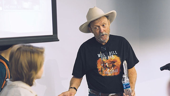 Local artist and author Bob Boze Bell talks to a student in Mohave Community College's art club Friday with a message of inspiration and advice about being rejected.