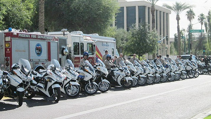 In this 2013 file photo, law enforcement officers from around the state gathered in Phoenix to officially kick off the holiday season DUI crackdown.