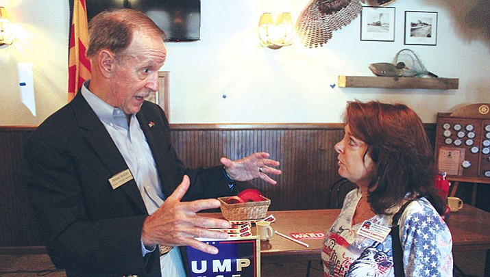 Frank Riggs, candidate for Arizona Superintendent of Public Instruction, talks to Barbara Carpenter at Monday's meeting of the Conservative Republican Club of Kingman. Riggs said he's for school choice, local control and quality education.