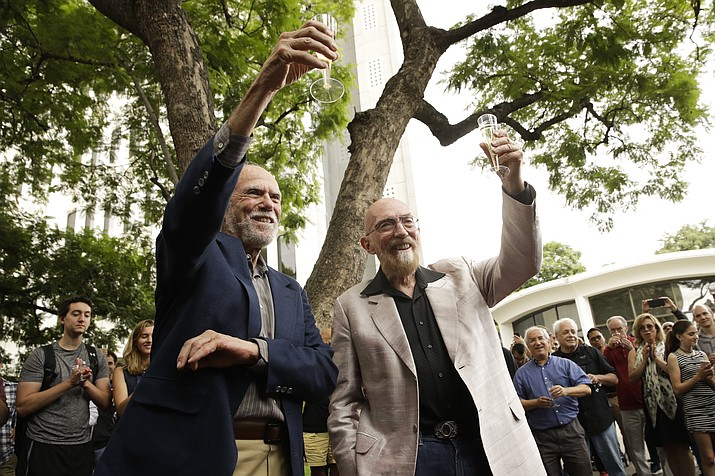 Scientists Barry Barish, left, and Kip Thorne, both of the California Institute of Technology, share a toast to celebrate winning the Nobel Prize in Physics on Tuesday, Oct. 3, 2017, in Pasadena, Calif. Barish and Thorne won the Nobel Physics Prize last week for detecting faint ripples flying through the universe, the gravitational waves predicted a century ago by Albert Einstein that provide a new understanding of the universe. Embry-Riddle's LIGO team contributed research to the Nobel Prize-winning project. (Jae C. Hong/AP)