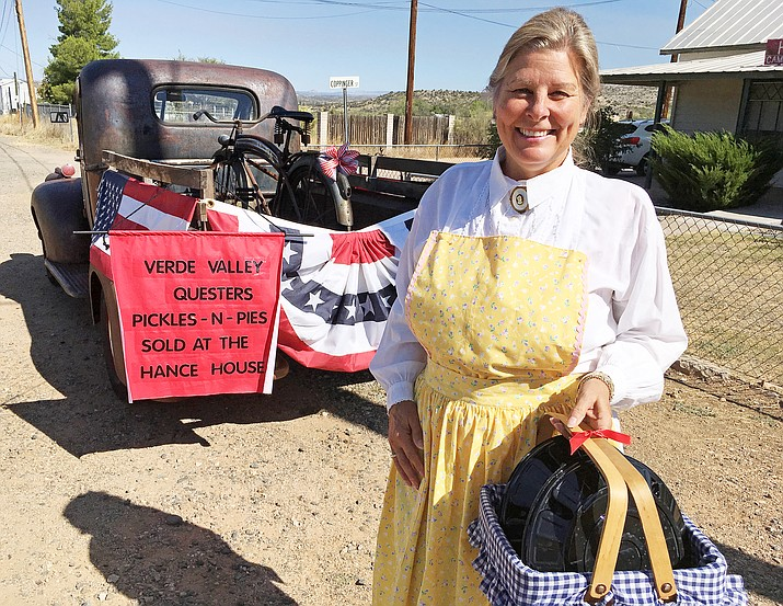 Nancy Futral of the Verde Valley Questers, pictured, with pickles and pies that represent the group's annual pickles and pies fundraiser. All money spent on pickles and pies Saturday will be used to restore the Historic Hance House on Coppinger Street, across from Fort Verde State Historic Park. (Photo by Bill Helm)