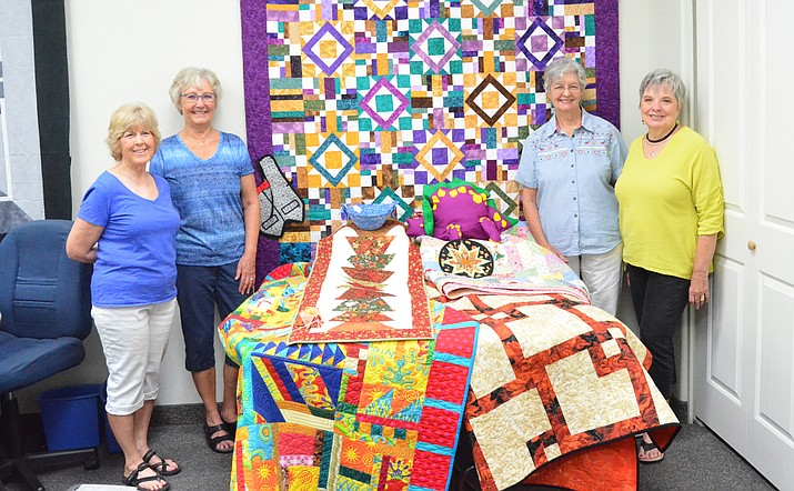 This is the quilt that the Quail Country Quilters will raffle at the Oct. 13-14 Covey of Quilts show at Cottonwood Middle School. Tickets are $1 each or $5 for six tickets. Pictured are Quail Country Quilters Janet Washburn, Charlene Dockray, Bev Lawrence and Janet Berry. (Photo by Vyto Starinskas)