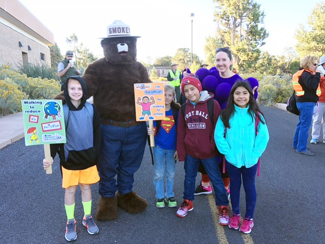 Grand Canyon students met at the clinic for a quick chat with Smokey the Bear before heading to school.