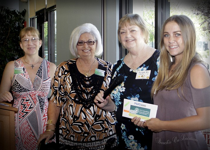 Claudelle Johnson, president of PWG, Kate Baker, member of both PWG and P.E.O. Chapter EL, and Margie Beach, president of Chapter EL, present a $1500 scholarship to Morgan Mabery at the PWG summer luncheon and fashion show at the Cottonwood Recreation Center. (Photo by Beach's On Location)