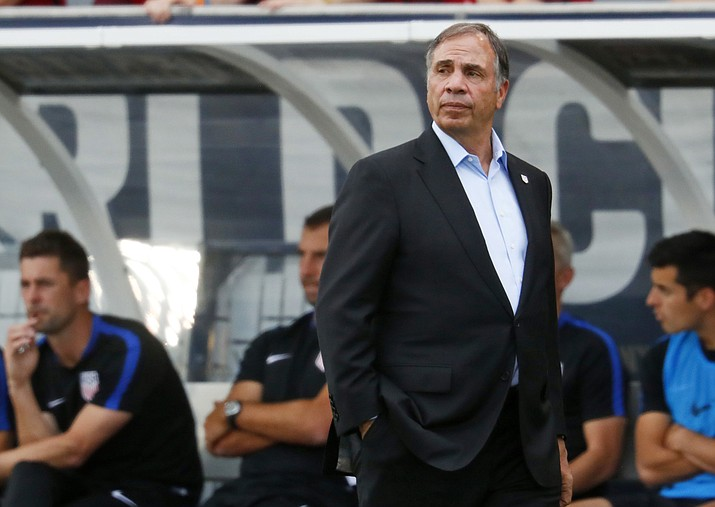 In this June 8, 2017, file photo, United States coach Bruce Arena watches during the first half of the team's World Cup soccer qualifying match against Trinidad & Tobago in Commerce City, Colo.  (David Zalubowski, AP file)