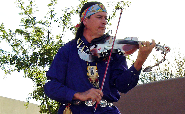 "Arvel Bird's violin and Native American flute performances encompass an extraordinary love of diversity -- from his contemporary international award winning Native American and Celtic rock orchestrations to traditional Celtic tunes and bluegrass standards, his performances have been heralded ""Braveheart Meets Last of the Mohicans ... at Woodstock."" Courtesy photo"
