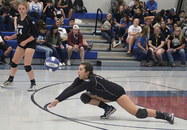 Kingman Academy's Krystal Howard digs the ball Tuesday against Parker. Howard and the Lady Tigers picked up a 3-1 victory to tally their third straight win.