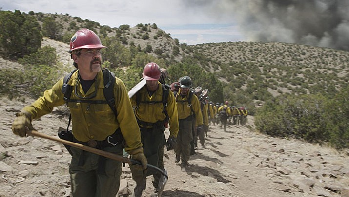 "Eric Marsh (portrayed by Josh Brolin) and the Granite Mountain Hotshots hike to their next assignment in ""Only the Brave."" The movie opens Oct. 20 nationwide."
