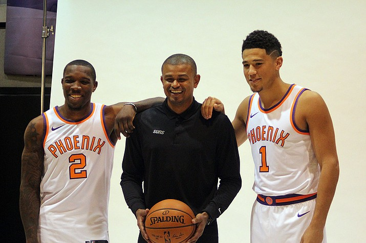 From left, Phoenix's Eric Bledsoe, head coach Earl Watson and Devin Booker will open the 2017 season Oct. 18 at home against Portland.