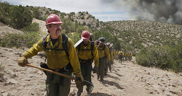 "Eric Marsh (portrayed by Josh Brolin) and the Granite Mountain Hotshots hike to their next assignment in ""Only the Brave,"" which opens nationwide Oct. 20. Visit the column at dCourier.com for photos, the movie trailer and more extras. (Sony Pictures)"